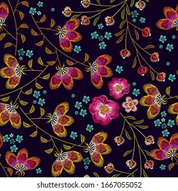 Embroidery flowers seamless pattern. Fashionable template for design of clothes. Beautiful camomiles, cornflowers