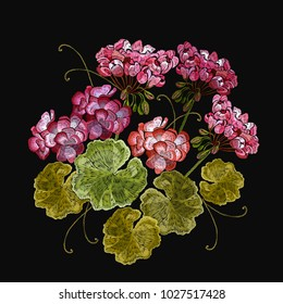 Embroidery geranium flowers in black background. Classical embroidery beautiful flowers of red geranium. Clothes template, t-shirt design