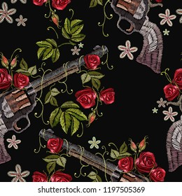 Embroidery guns and flowers roses seamless pattern. Template for clothes, textiles, t-shirt design. Symbol of romanticism and crime