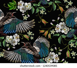 Embroidery magpie birds and cherry flowers seamless pattern. Template for clothes, textiles, t-shirt design