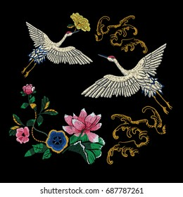 Embroidery oriental folk pattern with cranes, waves and lotus flowers. Vector embroidered floral sketch with Japanese birds for clothing design.