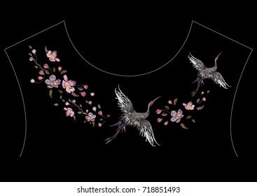 Embroidery oriental neckline pattern with cranes and cherry blossom. Vector embroidered floral patch with bird for clothing design.