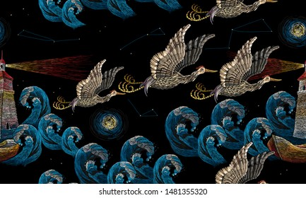 Embroidery pack of asian cranes flies over sea. Horizontal seamless pattern. Lighthouse and darkness ocean. Japan art. Template for clothes, t-shirt design