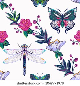 Embroidery patch with flowers, twigs and butterflies, dragonflies. Fashion patches with summer wild nature illustration embroideries. Seamless pattern backdrop. Traditional art on white background.