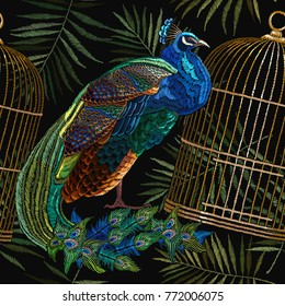 Embroidery peacocks and birds gold cage seamless pattern. Fashionable template for design of clothes