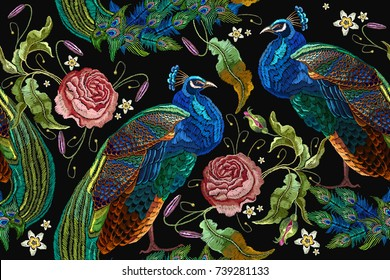 Embroidery peacocks and flowers peonies seamless pattern. Fashionable template for design of clothes. Tails of peacocks and roses