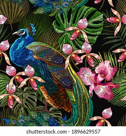 Embroidery peacocks and orchid exotic tropical flowers. seamless pattern. Fashionable template for design of clothes. Fashion tropical birds. Jungle forest art