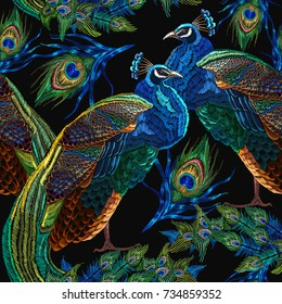 Embroidery peacocks seamless pattern. Fashionable template for design of clothes. Tails of peacocks