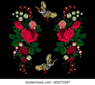 Embroidery pink roses, flowers and crane birds for decoration. Vector fashion embroidered ornament on a black background for textile, fabric traditional folk decoration
