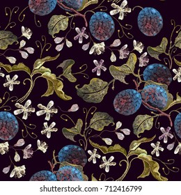 Embroidery plums branch seamless pattern template fashionable clothes, t-shirt design. Classical embroidery blossoming plum on black background