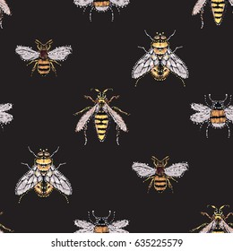 Embroidery and rhinestones yellow fly, big honey bee, big wasp, small funny bee. Fashion crystal patch with insects illustration. Seamless pattern on black background.