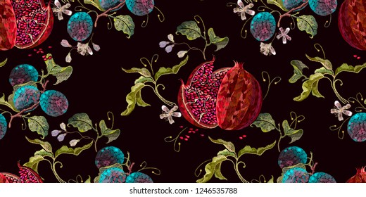 Embroidery ripened red pomegranate and flowers of cherry and plum seamless pattern. Template clothes, t-shirt design, textile design