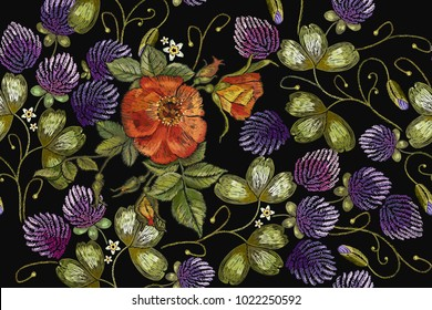Embroidery roses and pantone clover seamless pattern. Classical beautiful flowers clover and red roses spring flowers pattern. Fashionable template for design of clothes, t-shirt template