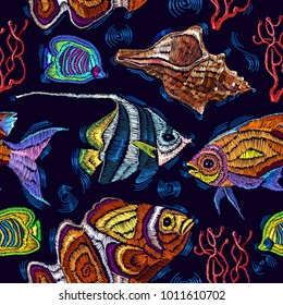 Embroidery sea life, sea shells, corals, tropical fishes seamless pattern. Classical embroidery tropical sea, wave, fishes, corals, shells seamless fashion pattern. Fashionable clothes