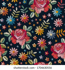 Embroidery seamless pattern with beautiful colorful flowers and leaves.  Fashion design. Print for fabric. Vector embroidered illustration.