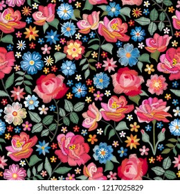 Embroidery seamless pattern with beautiful flowers. Bright floral print with spanish motives. Fashion design with satin stitch. Vector embroidered illustration.