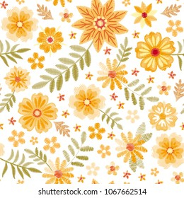 Embroidery seamless pattern with cute yellow flowers and green leaves on white background. Fashion embroidered design for fabric, textile, wallpaper. Vector illustration.