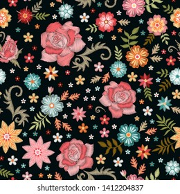 Embroidery seamless pattern with flowers in vintage style. Fashion embroidered design for fabric, textile, wallpaper.