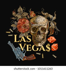 Embroidery skulls and guns, dice, Las Vegas slogan. Casino concept. Wild west embroidery old revolvers, roses, human skulls, gangster gothic Las Vegas art
