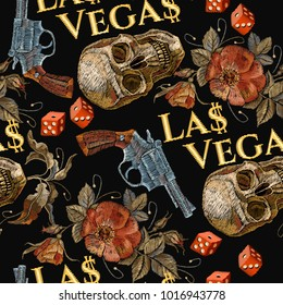 Embroidery skulls and guns, dice seamless pattern. Las Vegas slogan. Casino background. Wild west embroidery old revolvers, roses, human skulls, gangster gothic Las Vegas pattern