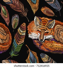 Embroidery sleeping fox and color feathers seamless pattern. Classical embroidery seamless background. Red fox sleeping in beautiful feathers. Fashionable template for design of clothes
