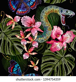 Embroidery snake, butterflies and tropical orchid flowers seamless pattern. Jungle summer art . Fashion template for clothes, textiles, t-shirt design
