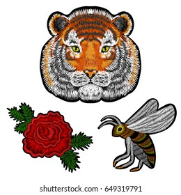 Embroidery Tiger face, bee insect, embroidered rose patches on black, vector for fashion textile design. Fabric modern decoration.