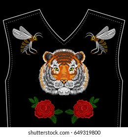Embroidery Tiger face, bee, roses for neckline. Vector fashion embroidered ornament on black background for fabric traditional folk floral decoration.