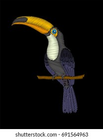 Embroidery toucan bird isolated on black background.