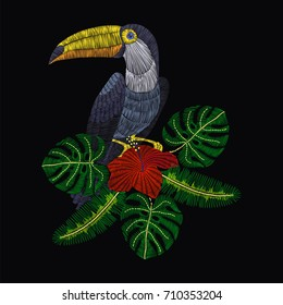 Embroidery toucan with tropical hibiscus flowers. Vector artwork illustration for fashion clothing, patches and stickers. Exotic bird and hawaii leaves for decor, fabric design elements.