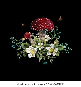 Embroidery traditional floral pattern with mushroom, berries, forget me not and bees. Vector embroidered bouquet with flowers for wearing design.
