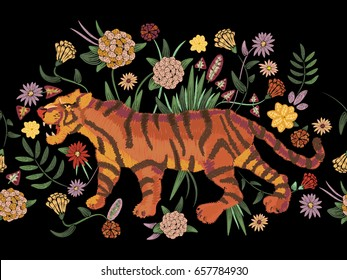 Embroidery traditional folk seamless pattern with tiger and flowers. Vector native floral design with animal for fashion wearing.