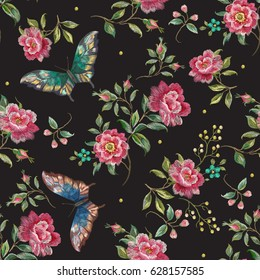 Embroidery trend floral seamless pattern with roses and exotic butterflies. Vector traditional folk flowers decor on black background for clothing design