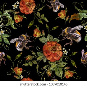 Embroidery wild roses flowers and bumblebees. Classic style embroidery, beautiful dogrose pattern vector. Vintage buds of wild roses on black background. Fashionable template tapestry flowers