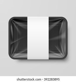 Empty Black Plastic Food Container with Label on Gray Background