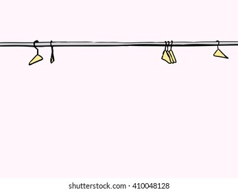 Empty clothes hangers scattered along metal rod over white background