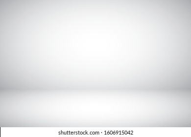Empty gray studio abstract background with spotlight effect. Product showcase backdrop.