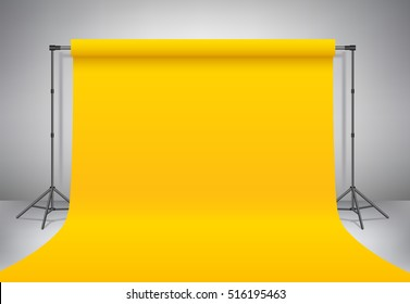 Empty photo studio. Realistic template mock up. Backdrop stand (tripods) with yellow paper backdrop. Gray background. Vector illustration.