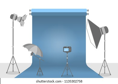 Empty photostudio with various equipment for photoshoots and blue background. Camera, softbox, decoration and spotlights. Isolated flat vector illustration