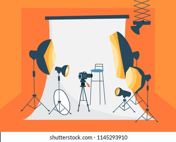 Empty photostudio with various equipment for photoshoots and white background. Camera, softbox, decoration and spotlights. Flat vector illustration