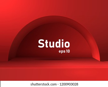 Empty red studio table with arch and recess. Free space for product presentation.