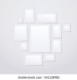 Empty white photoframes set on the blank white wall. Vector illustration
