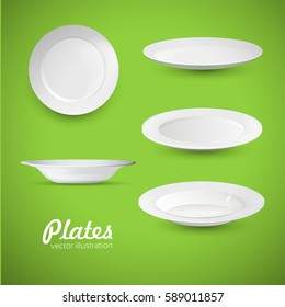 Empty white plates on the green background