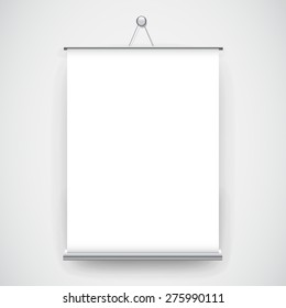 Empty white roll up banner hanging on the wall background