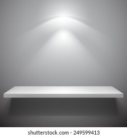 Empty white shelf with light from top