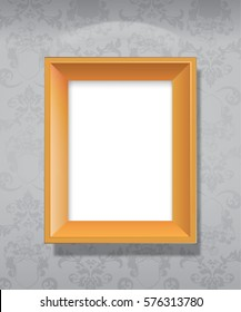 Empty wooden picture frame hanging on wall.