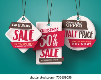 End of season Christmas sale vector set of red sale tags hanging with half price text and with origami paper style for holiday discount promotion. Vector illustration.