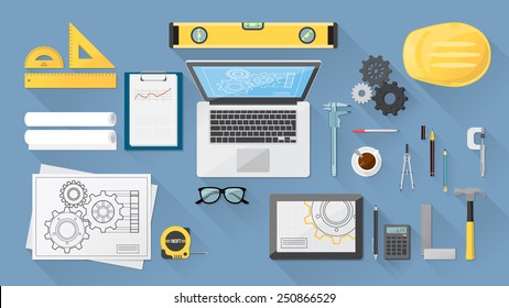 Engineer's desktop with work tools, computer and tablet
