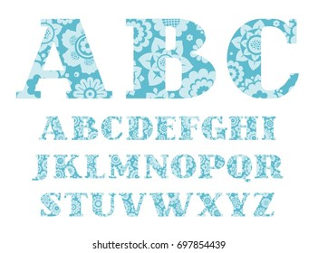 English font, blue flowers, vector. English alphabet. Capital letters with serifs. On the blue letters painted light blue decorative flowers.