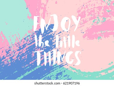 Enjoy the Little Things - inspirational quote poster design. Hand lettered text in white on a colorful abstract brush strokes background.